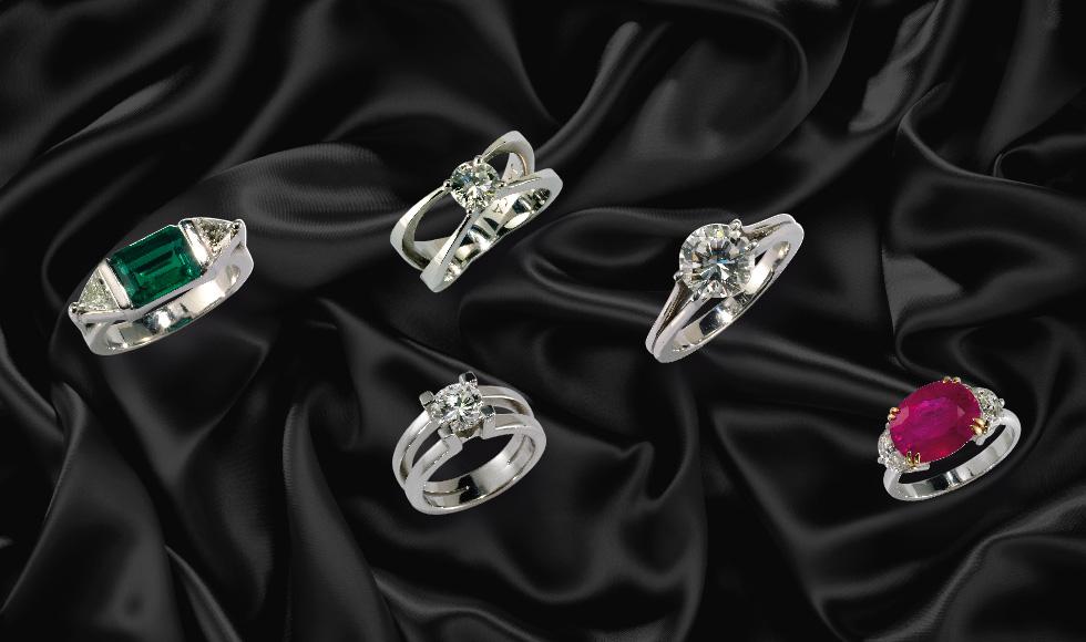 Alianzas y solitarios en oro blanco con diamantes, rubíes y esmeraldas